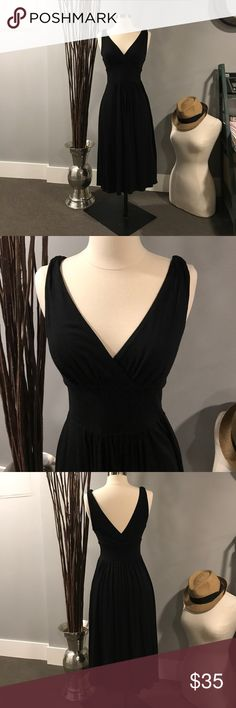 Vince Dress Perfect black Vince dress.  Plunging neckline and back.  Pockets.  This dress can be dressed up or down. This dress runs small. Would best fit a small Vince Dresses
