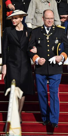 Prince Albert and his wife Princess Charlene followed by the rest of the royal family...