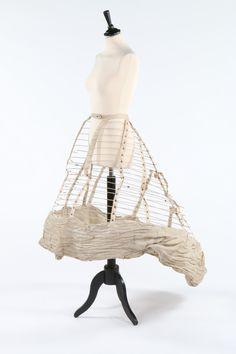 A Thomson crinoline cage, circa 1860. the waistband stamped 'Celebre Jupe Cage Thomson, Paris, Brevet Milliet', with cotton lattice weave ba...