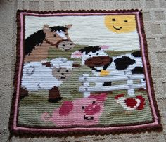 How cute! This was someone's first attempt at intarsia and look how awesome it is. I've gotta try this sometime.