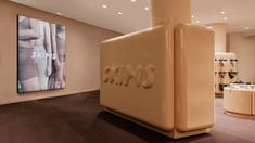 Designer Willo Perron has designed the first pop-up store for Kim Kardashian's underwear brand SKIMS, which is in Paris and furnished with glossy, chunky display units and partitions.
