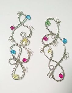 Let the sun shine in! Brighten up your view, with one or more of these beautiful sun catchers on your window, door, or even mirror. Silver tone wire with crystal beads.