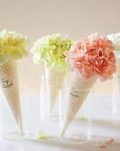 I neat flower idea that can be used as the centerpieces and allowed to go home with your guess afterward!