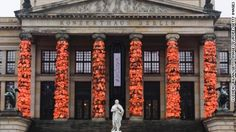 Chinese artist Ai Weiwei has covered a Berlin landmark with thousands of discarded life jackets in his latest installation.