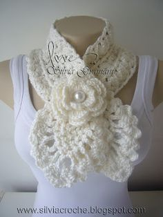 Crocheted scarf with flower.