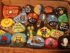 Painted rocks by Phyllis Plassmeyer.