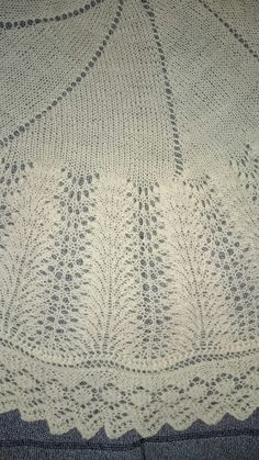 SHETLAND ROUND CHRISTENING BABY SHAWL IN TRADITIONAL PATTERN AND WIDE LACE OUTTER BORDER. JUST STANDS OUT OF CROWD.   MADE FROM QUALITY 2PLY 100% MERINO WOOL IN OFF WHITE AND MEASURES APPROXIMATELY 116 CM IN DIAMETER.  THIS SHAWL WEIGHTS LESS 200 GRAMS, LIGHT AND BREATHABLE.  WILL MAKE A REAL HEIRLOOM TO PASS FROM GENERATION TO GENERATION.  HAPPY TO MAKE TO ORDER IN PINK OR BLUE.  PLEASE ALLOW 3-4 WEEKS TO COMPLETE YOUR ORDER   MACHINE WASHABLE. GENTLE MACHINE WASH IN WARM WATER.  FREE…