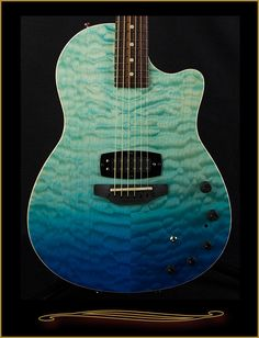 Tom Anderson Crowdster Plus in Natural to Bora Blue Surf with Quilt Maple Top at TheGuitar Sanctuary McKinney Texas
