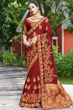 Maroon satin silk saree with maroon art silk blouse. Saree embellished with resham work, stone and zari work. Saree with Round Neck, Half Sleeve. It comes with unstitch blouse, it can be stitched to 32 to 58 sizes. #weddingsaree #weddingwearsaree #festivalwear #partywearsaree