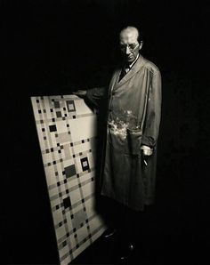 "Piet Mondrian (1872-1944) with his last finished painting ""Broadway Boogie Woogie"". Photo: Fritz Glarner, 1943"
