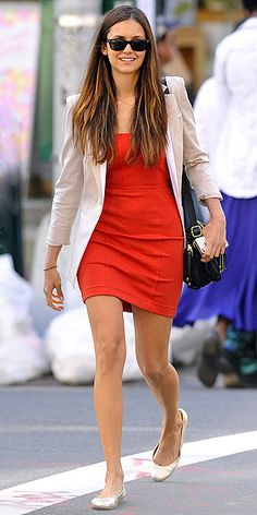 A red dress gets summerized with a cool neutral blazer and ballet flats.