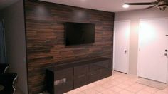 Dark wood flooring on tv wall