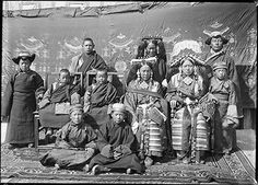 Expedition: Sir Charles Bell's Mission to Lhasa 1920-21, Date of Photo: April 17th 1921?, Named Person: Ragashar Family, Region: Lhasa, Ragashar House Ragashar, his brother (both seated), Ragashar's wife standing next to Ragashar's brother. Two male members of household standing behind.  Also two female members of the household, one wearing several ornaments.