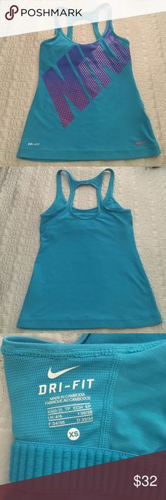 Nike Workout Top Excellent condition Nike Dri-Fit workout top. Blue with big NIKE graphic in the front.  Size xs.  Has a built in shelf bra but does NOT have any padding. The Scoop neck in front is somewhat low.  Make an offer! Nike Tops