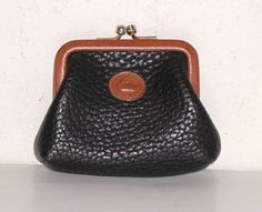 Love these little kiss lock coin purses from the vintage Dooney & Bourke All Weather Leather collection.