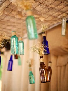 www.rust-n-lace.com  Repurposed baby bed spring with colored bottles . Great  backdrop!