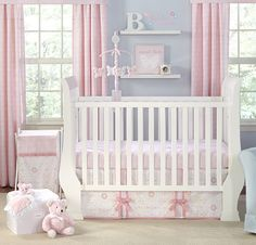 Pink and blue nursery with touches of yellow and green in the pattern - Wendy Bellissimo Willow