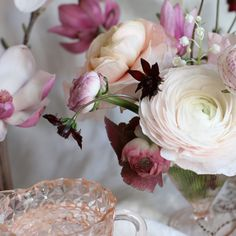 vintage pink depression glasses + magnolias, Japanese ranunculus, chocolate cosmos, and lily of the valley