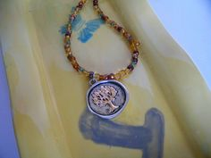 Necklace has Multicolored Seed Beads with a Tree of Life Pendant by kaysjewelrydesign on Etsy