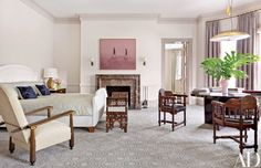 In the master bedroom, a 1950s Austrian pendant light from Eric Appel is juxtaposed with late-19th-century Moorish chairs and a 1920s armchair attributed to Paul Poiret's Atelier Martine from Bernd Goeckler Antiques; the carpeting was custom made by Tai Ping.
