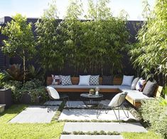 Good entertaining space in a small garden Bamboo could be repeated both at the end of the garden and along the side alley