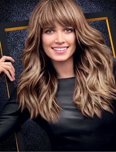 Helena Bordon wear the Fall/Winter 2014 trend: Ash blonde bangs and waves. The CUT: Loose, tousled waves with the addition of a statement fringe. The COLOR: Ash blonde.