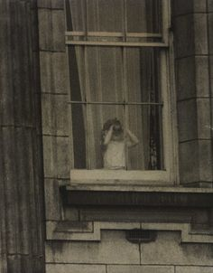 Prince Charles looking out of the window at Buckingham Palace on the day of his mother's, Queen Elizabeth II, coronation.