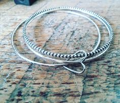 A personal favorite from my Etsy shop https://www.etsy.com/listing/266359216/open-heart-bangle-set-sterling-silver