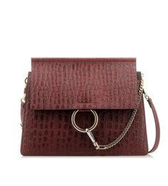 Bolso de Chloé rojo Faye con estampado de cocodrilo.Asa ajustable y extraíble.Detalle de cadena dorada para cierre.Compartimentos interiores y bolsillo interior....