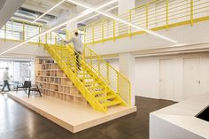 from bright yellow finishes to podium-like staircases, the space allows for flexibility and comfort and open floor interactions.