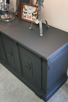 Used Annie Sloan graphite chalk paint. I wanted this sideboard to be black rather than dark grey, so after I clear waxed it, I mixed the dark wax with unscented mineral spirits to make a dark wax glaze.  This really deepened the color and turned it into a gorgeous, soft black.