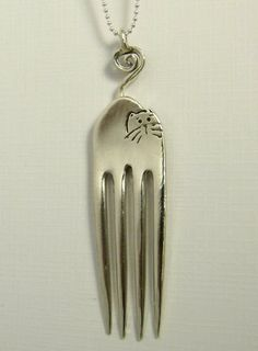 http://www.etsy.com/nl/listing/166471077/cleothe-fork-cat-up-cycled-sterling-fork?ref=shop_home_active_22