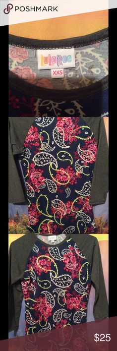 Adorable paisley and floral LULAROE shirt SizeXXS Shazam!!! Lovely Lularoe shirt ! Get it while the getting's good!!! ❤️❤❤❤ super cute and slender! Dark grey sleeves LuLaRoe Tops Tees - Long Sleeve