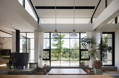 Hut in Tsujido is a minimalist residence located in Tokyo, Japan, that's a hut-like building designed to correspond with the surrounding scenery.