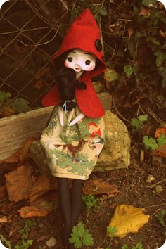 OOAK Art Doll made of cloth and clay. The dress is made with antique fabric with the illustrations of theLittle Red Riding Hood. Size: 45