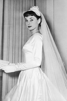 Meghan Markle wore a Givenchy wedding dress for the royal wedding. The look is reminiscent of Audrey Hepburn, an original Givenchy muse. Boda Audrey Hepburn, Audrey Hepburn Wedding Dress, Modest Wedding Dresses, Wedding Gowns, Bridal Gown, Givenchy Wedding Dress, Wedding Movies, My Fair Lady, Nicole Kidman