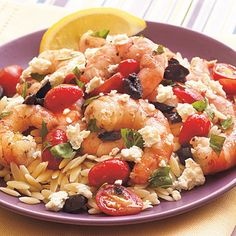An authentic Greek trio of tomatoes, olives, and feta cheese accompanies this shrimp dish. Serve over orzo, and garnish with lemon wedges...