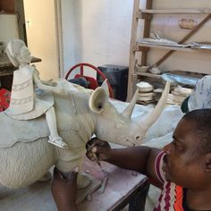 Alex Sibanda sculpting a rhino rider at Ardmore studio