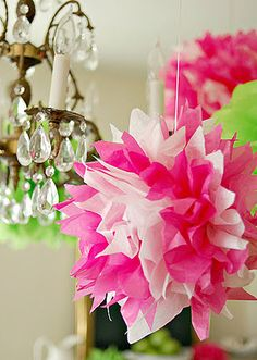 make tissue paper pom-poms using two colors of tissue paper