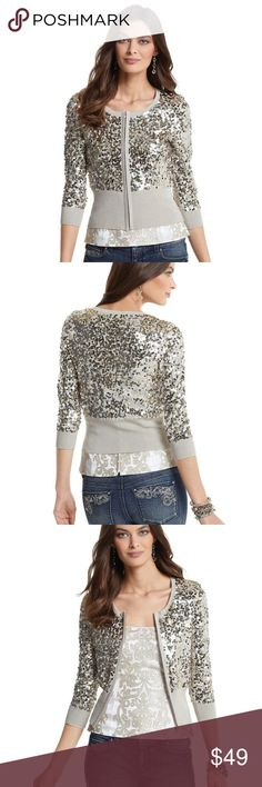 White House Black Market SEQUINED SWEATER JACKET White House/Black Market GOLD & SILVER SEQUINED SWEATER JACKET  DETAILS Color: gold metallic-infused neutral Silver tone zipper pull Small sequins have double-sided sparkle  Ribbed peplum reaches to smallest part of the waist  3/4 sleeves. Lined in silky charmeuse, except sleeves. Hits at mid-hip Shell: 70% Rayon, 30% Nylon Lining: 100% Polyester, silky charmeuse. ( Hand Wash, Lay Flat to Dry )  Retails for: $148  Approx. Measurements…