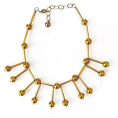 Glass antique brass spheres are attached to lightweight golden tube beads…
