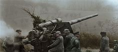 German soldiers firing the 88mm FlaK gun in the early hours of 16 December 1944 at the beginning of Ardennes Offensive.