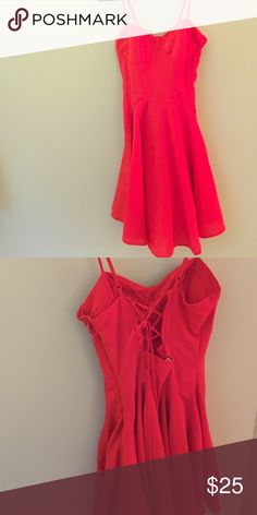 Sexy red corset style dress Corset look without the discomfort. This dress has the lace up of a corset in the back, lightly padded bust- so it can be worn braless. The length is just about the knee. Charlotte Russe Dresses Mini