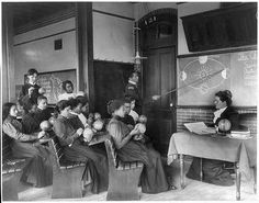 A class in mathematical geography studying earth's rotation around the sun, Hampton Institute, Hampton, Virgini; Johnston, Frances Benjamin, 1864-1952, photographer; 1899; Library of Congress Prints and Photographs Division Washington, D.C.