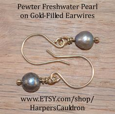Freshwater Pearl Earrings (dyed) Pewter, on hand-made Gold-Filled fish-hook Earwires. Pearls are associated with the moon and with water. They can enhance a feeling of femininity, helping you access your inner Goddess. They are calming and help you feel centered.  Pearl is the birthstone for Gemini and June birthdays. I infuse my Hand Made Jewelry with the intention to Heal and Empower, then cleanse and charge it especially for you when I package it for shipping.