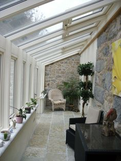 A glazed walkway opens up the side of a house. Works really well to extend a terrace.