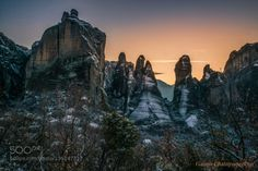 The praying rocks by yiannischatzipanagiotis  Yiannis Chatzipanagiotis beautiful cliff clouds forest mountains prime rocks sky snow. sunset travel