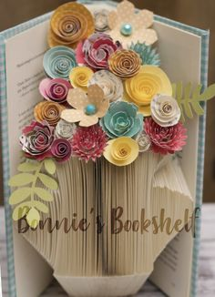 Hand folded book art in the shape of a vase with handmade paper flowers. Makes a perfect gift for birthday, anniversary, or a thank you gift. Why spend so much on real flowers that die in a week when you can get these that last forever Paper Flower Vase, Paper Flower Arrangements, Flower Vases, Folded Book Art, Book Folding, How To Make Paper Flowers, Real Flowers, Thank You Gifts, Book Crafts