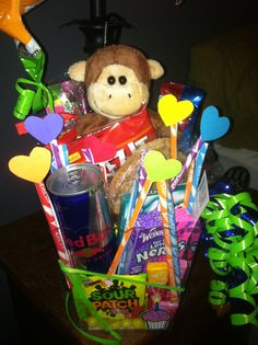 Goody bucket for boyfriend's birthday.  All his favorite snacks and candies, and a little cute monkey. We like stuffed animals : )