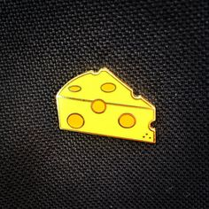 This little cheese slice pin is made of high quality hard enamel with gold plating. Its the perfect accessory for cheese lovers! Approximately 23 mm